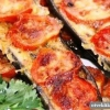 Як приготувати баклажани запечені в духовці з помідором і сиром?