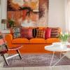 Помаранчева вітальня (18 фото): красиві поєднання в інтер`єрах
